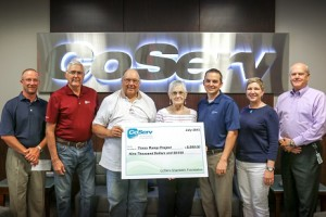 Duane Compton, Texas Ramp coordinator for Cooke, Fannin and Grayson counties (third from left) joins Beverly Ford, regional coordinator for other North Central Texas counties (center) to accept a $9,000 CoServ Charitable Foundation grant from (left to right) CoServ District 4 Board Director Clint Bedsole and District 1 Board Director Richard Muir, Senior Vice President of Information Systems Stacia Sims and Senior Vice President of Operations Jody Forman. (Photo by Dawn Cobb)