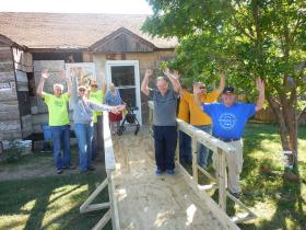 Provided photo: Diane R., 62, celebrates with Texas Ramp Project volunteers Saturday after receiving an access ramp.